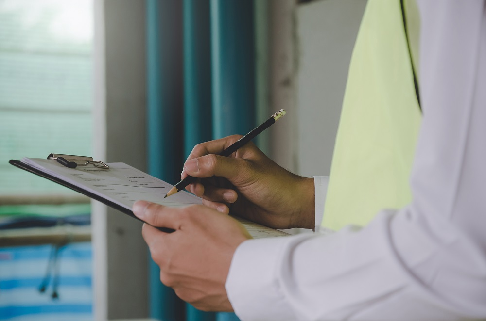 Man Checking List for Home Inspection